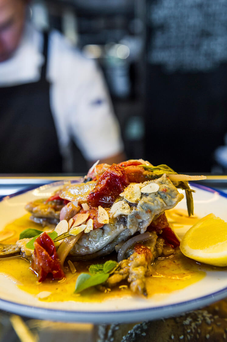 Rushcutters Fried sardines roasted tomatoes almonds and oregano The Keystone Group Est Magazine