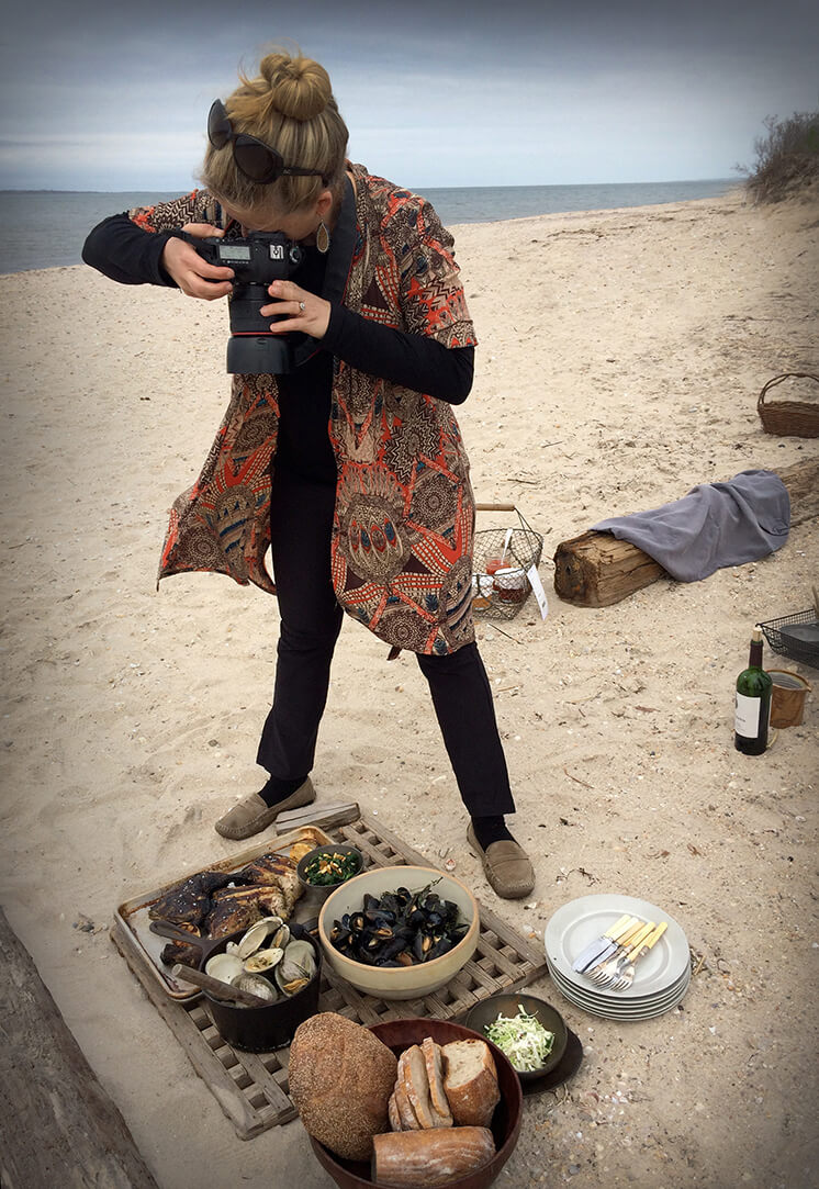 Est Magazine Robyn Lea Author Photographer Robyn Lea on location on one of Pollocks favorite beaches Louse Point