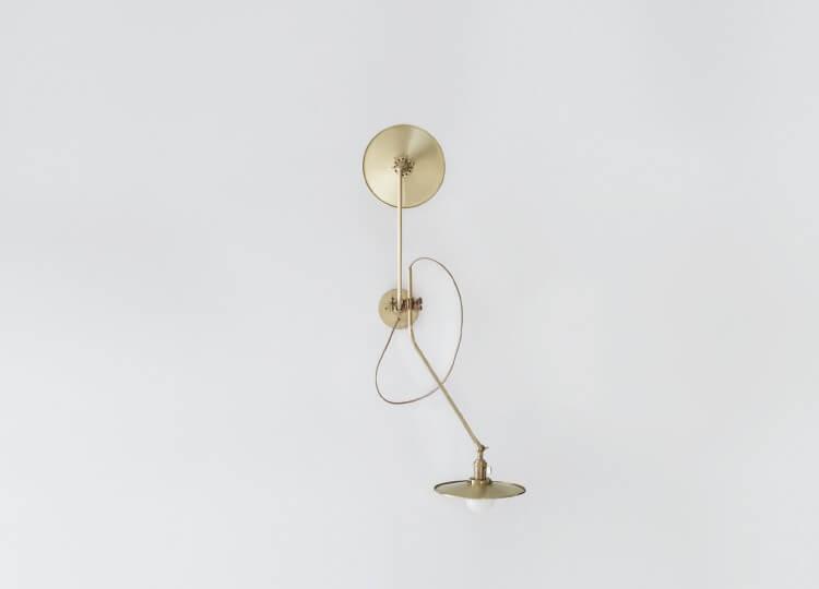 Brass Bent Wall Lamp   Est Living Design Directory