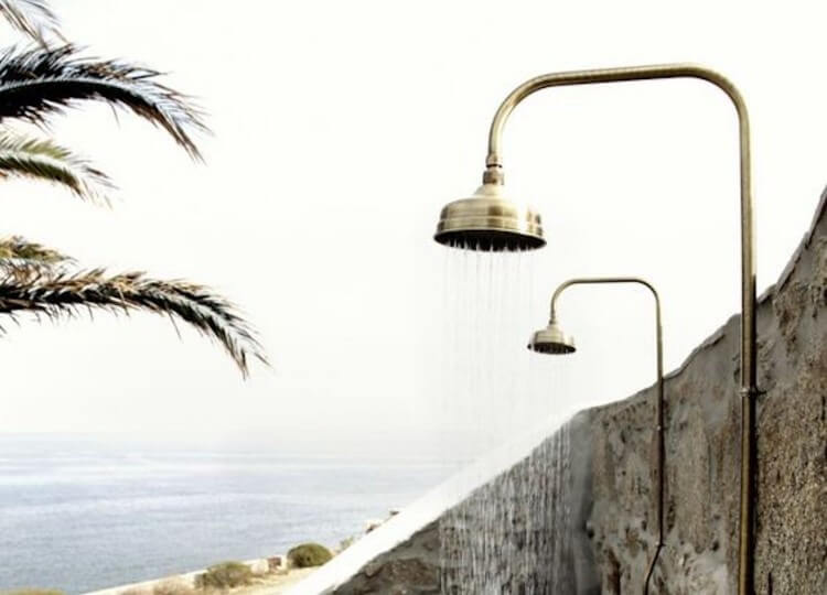 est living outdoor showers san giorgio mykonos feature 750x540